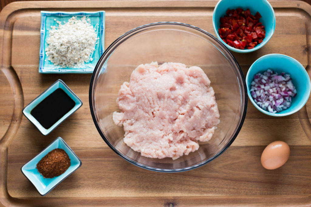 Over head shot of individual ingredients to make turkey burgers