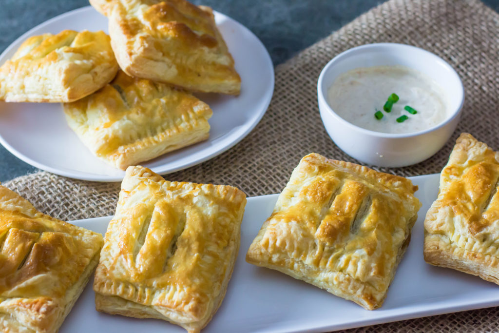 Beef wellington puff pastries with horseradish dipping sauce