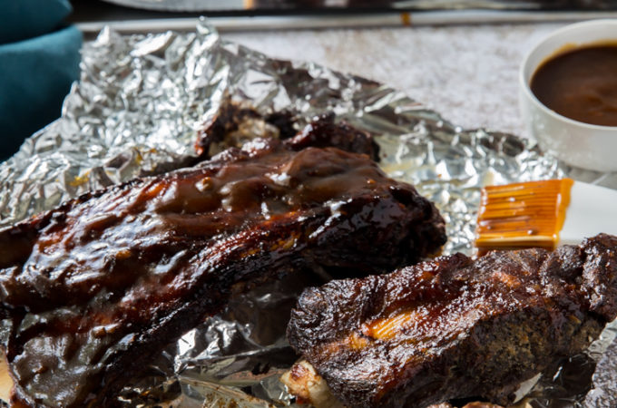 easy instant po beef ribs cooked topped with low carb BBQ sauce on aluminum foil