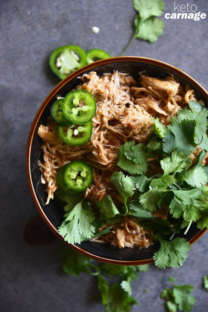 image of shredded bbq chicken in a bowl topped with cilantro