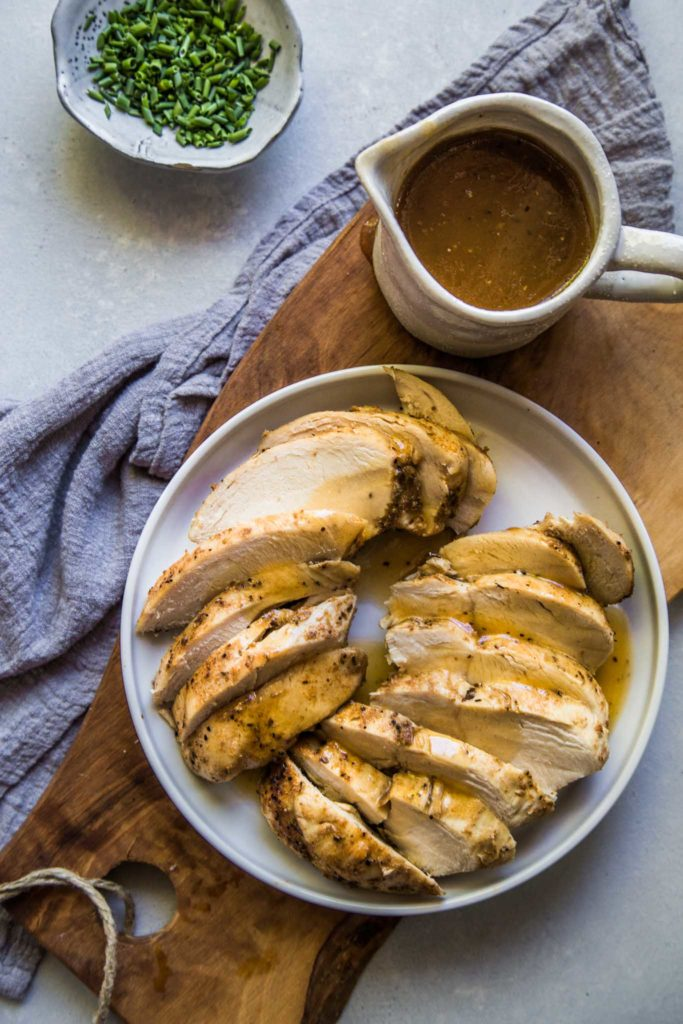 image of sliced chicken breast topped with gravy