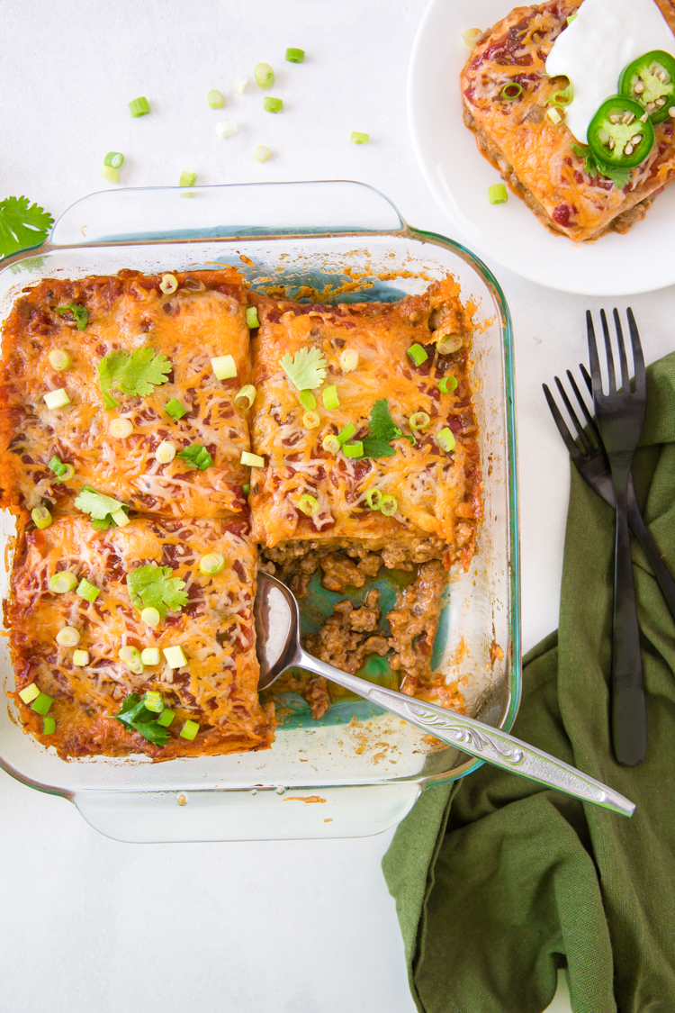 Keto Mexican Casserole in a glass dish with forks and a green napkin