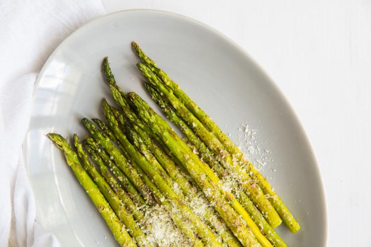 roasted garlic parmesan asparagus on a light plate